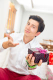 Handsome joyful young man holding Christmas Royalty Free Stock Image