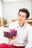 Handsome joyful young man holding Christmas Royalty Free Stock Photo