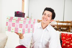 Handsome joyful young man holding Christmas Stock Photo