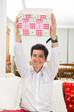 Handsome joyful young man holding Christmas Stock Photos