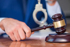 The handsome judge with gavel sitting in courtroom Royalty Free Stock Photography