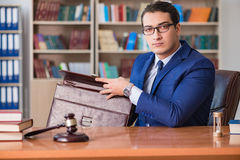 The handsome judge with gavel sitting in courtroom Stock Photo