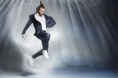 Handsome jumping businessman wearing elegant stuff Royalty Free Stock Photos