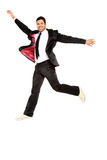 Handsome jumping man on suit Royalty Free Stock Photos