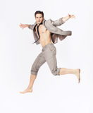 Handsome jumping man on suit isolated on a white background Royalty Free Stock Image