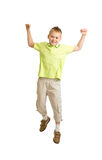 Handsome kid boy jumping or dancing on white. Background Royalty Free Stock Photo