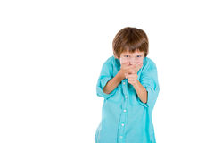 A handsome kid giggling covering his mouth with his hands Stock Image