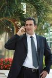 Handsome Latin business man talking Stock Image