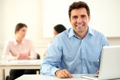 Handsome latin businessman smiling at you Stock Image