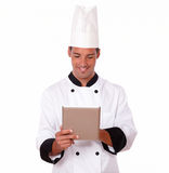 Handsome latin chef using his tablet pc Stock Photography