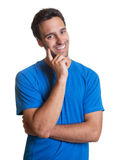 Handsome latin guy in a blue shirt Stock Photography