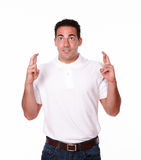 Handsome latin guy with luck sign Royalty Free Stock Photography