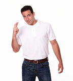 Handsome latin guy with luck sign Stock Photos