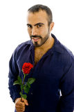 Handsome Latin guy offering rose Stock Images