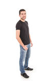 Handsome latin guy posing with jeans and black Royalty Free Stock Images