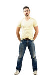 Handsome latin male model smiling. Full body length portrait isolated over white background Royalty Free Stock Image