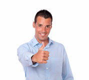 Handsome latin man with positive thumb sign Stock Photos