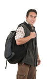 Handsome latin young man wearing backpack and vest Royalty Free Stock Photo