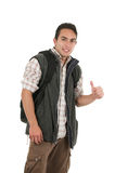 Handsome latin young man wearing backpack and vest Royalty Free Stock Image