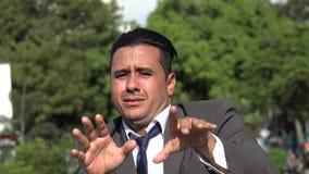 Fearful Hispanic Business Man. A handsome latino business man stock video