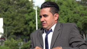 Fearful Hispanic Business Man Shooing And Rejection. A handsome latino business man stock video footage
