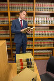 Handsome lawyer in the law library Royalty Free Stock Images