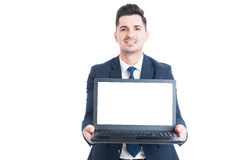 Handsome lawyer in suit holding notebook laptop in his hands Stock Photos