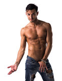 Handsome lean, shirtless man in jeans Stock Photo
