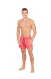 Handsome lifeguard with red swimsuit Stock Photos