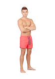Handsome lifeguard with red swimsuit Stock Photography