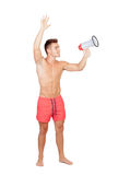 Handsome lifeguard with red swimsuit and megaphone Stock Photos
