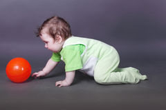 Handsome little baby boy crawls Royalty Free Stock Images