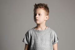 Handsome little boy in grey t-shirt Stock Images