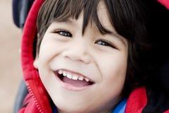 Handsome little boy smiling, closeup Stock Photos