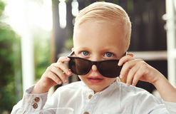 Handsome little boy in trendy sunglasses royalty free stock photography