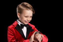 Handsome little boy in a tuxedo Stock Photos