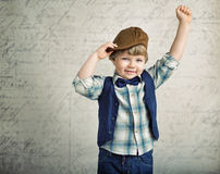 Handsome little boy with a victory gesture