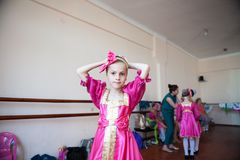 Beautiful little girl in Russian national costume at the school dance stock photography