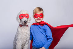 Handsome little superman with dog. Superhero. Halloween. Studio portrait over white background Stock Photo