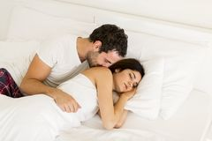 Young couple in the bed Stock Photos
