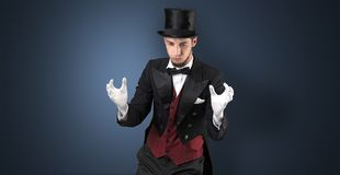 Magician holds something invisible. Handsome magician with no graph holds something invisible stock image