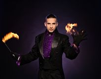 Handsome magician Stock Photo