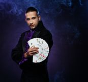 Handsome magician Stock Images