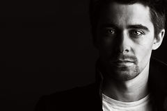 Handsome Male. Low Key Shot of a Handsome Male against a Dark Background Royalty Free Stock Images