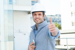 Handsome male architect gesturing thumbs up Royalty Free Stock Image