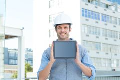 Handsome male architect showing digital tablet Royalty Free Stock Photography