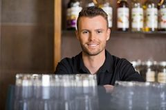 Handsome Male Barista At Coffeeshop Royalty Free Stock Photography