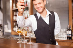 Handsome male bartender is making alcohol beverage Royalty Free Stock Photo