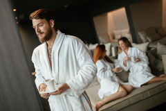 Handsome male in bathrobe drinking tea Royalty Free Stock Images