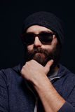 Handsome male big beard in glasses and hat Royalty Free Stock Photo